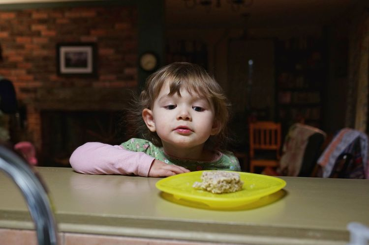 I'd like to eat that now. Childhood Child Children Only Food And Drink Table Close-up Portrait Front View Headshot One Person Dessert Time! Dessert Rice Krispy Treat Temptation Domestic Life Self Control Waiting Desire Food
