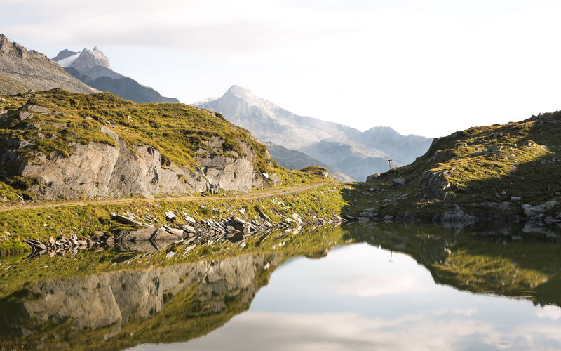 Reflection Spiegelung Beauty In Nature Bergsee Cloud - Sky Day Environment Idyllic Lake Landscape Mountain Mountain Peak Mountain Range Nature No People Non-urban Scene Outdoors Remote Rock Scenics - Nature Sky Tranquil Scene Tranquility Water
