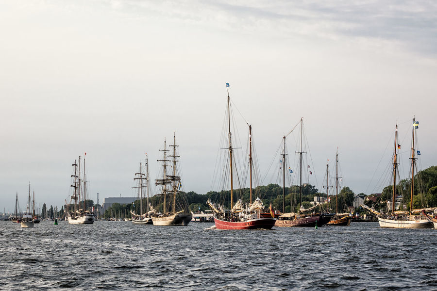 Sailing ships on the river Warnow in Rostock, Germany. Day Hanse Sail HanseSail Journey Mast Mode Of Transport Moored Nature Nautical Vessel No People Outdoors River Rostock Sailing Ship Sky Tall Ship Tourism Transportation Travel Destinations Vacation Warnow Water Windjammer