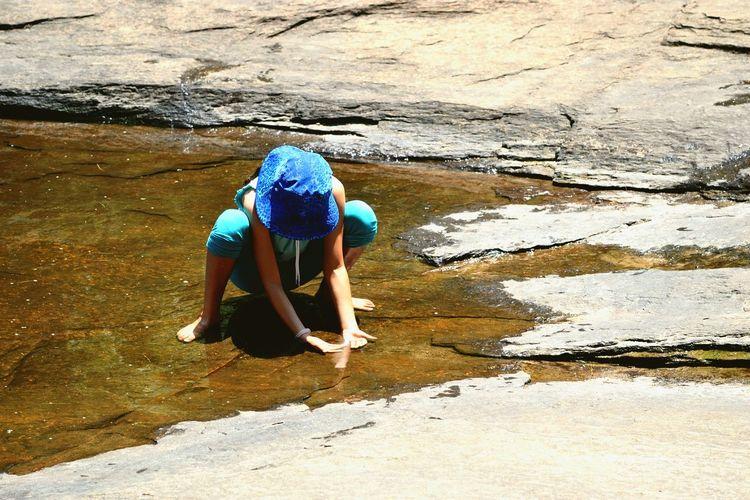 Child Playing In Water Childhood Memories Girl With Blue Hat Blue Hat Girl Playing In River The Great Outdoors - 2018 EyeEm Awards