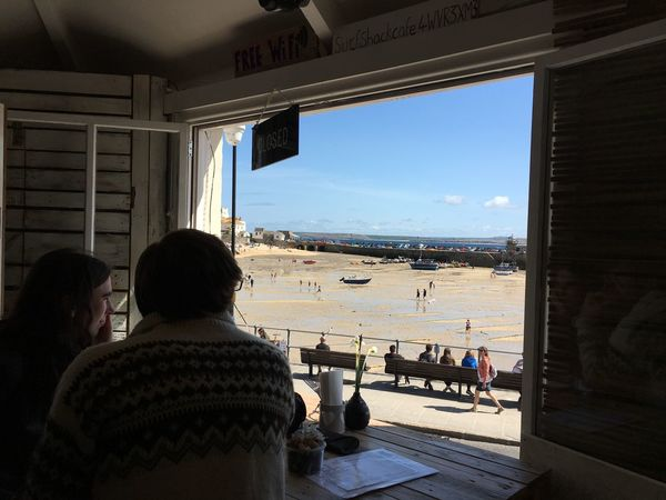 People looking out of a cafe window in St Ives, Cornwall, United Kingdom Adult Architecture Beach Cornwall Day Friendship Indoors  Leisure Activity Lifestyles Nature People Real People Rear View Sea Sky St Ives St Ives Harbour St IVES, CORNWALL Togetherness Two People