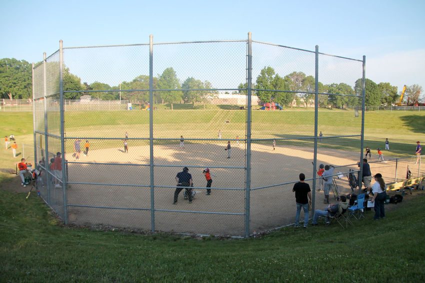 Kids Playing Baseball Match Baseball Competitive Sport Effort Field Grass Grassland Green Green Color Large Group Of People Men Net - Sports Equipment Park - Man Made Space Person Playing Practicing Relaxation Soccer Player Sport Sports Team Sportsman Team Sport Teamwork Togetherness