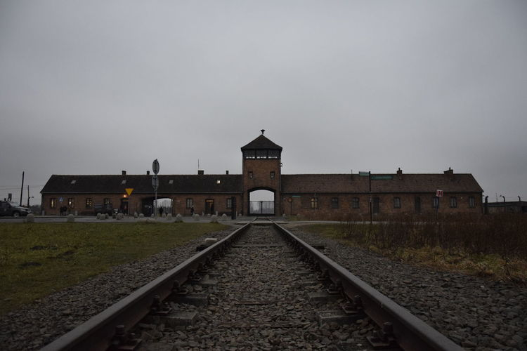 Auschwitz-Birkenau Silence Silent Moment Sadness And Sorrow Sadness Auschwitz  Restinpeace Respect Never Forget Holocaust Memorial Holocaust Auschwitz Birkenau Auschwitz Memorial Memory Poland Photography Cloudy Cloudy Day Cloudy Sky NeverForget Horses Travel Destinations History Railroad Track Sky