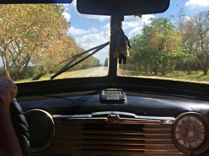 An Eye For Travel Cuba Cuba Collection Street View Car Car Interior Car Point Of View Cuban Cars Dashboard Driving Human Hand Mode Of Transport Old Car Real People Transportation Vehicle Interior Vintage Cars Window Windscreen Windshield