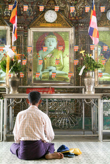 Yangon Adult Adults Only Architecture Burma Day Flag Indoors  Lifestyles Men Myanmar One Man Only One Person People Real People Rear View Religion Sitting Spirituality Sule Paya
