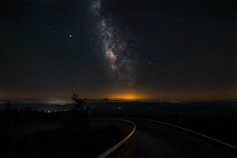 Scenic view of silhouette landscape against star field at night