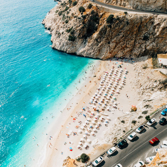 Sea Water Land Beach High Angle View Transportation Mode Of Transportation Car Nature Beauty In Nature Rock Scenics - Nature Motor Vehicle Day Rock - Object Solid Outdoors Travel Travel Destinations No People Turquoise Colored Luxury
