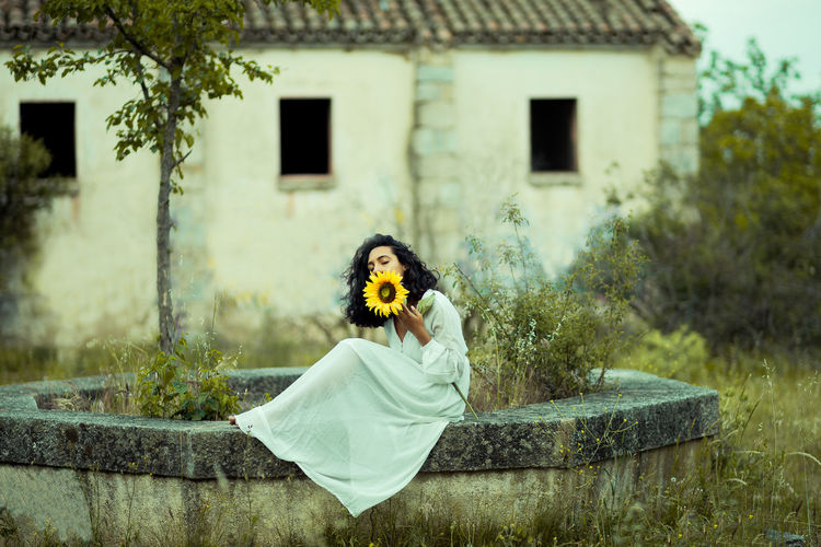 Woman Holding A Sunflower