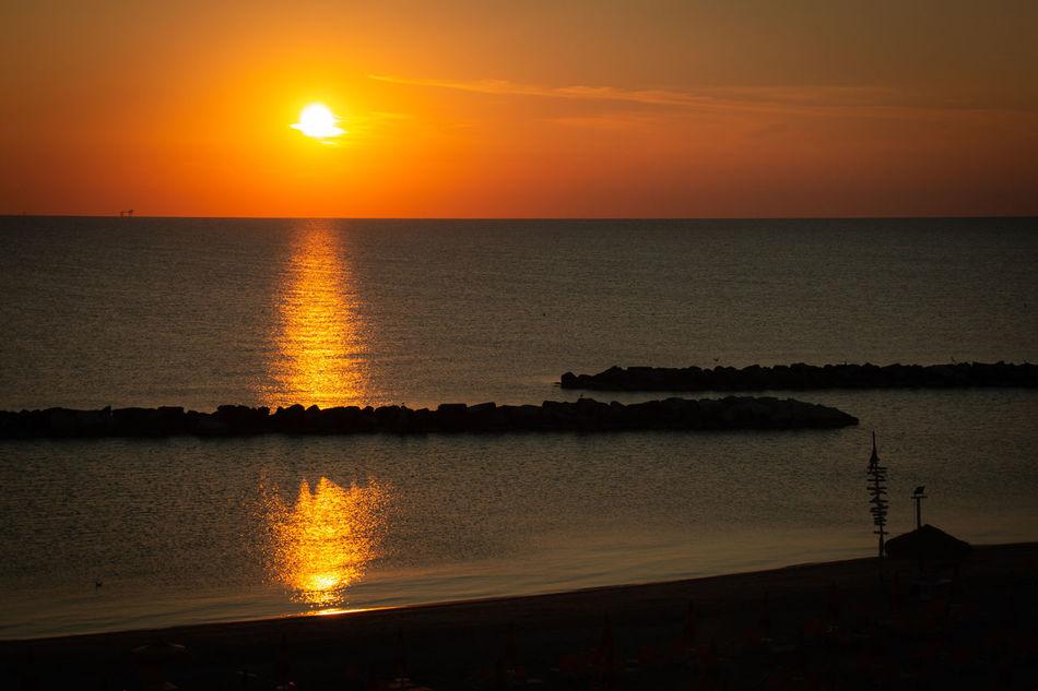 Sunrise on the Adriatic Sea in Italy Water Sky Sunset Scenics - Nature Sea Beauty In Nature Tranquility Tranquil Scene Horizon Horizon Over Water Sun Reflection Silhouette Orange Color Nature Sunlight Idyllic No People Non-urban Scene Outdoors Torre Pedrera Adriatic Sea Sunrise Sunshine
