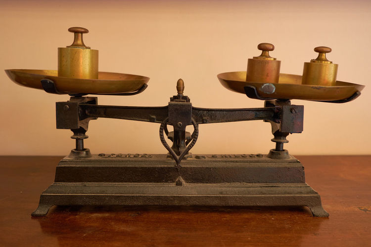Close-up of vintage weighing scale on table
