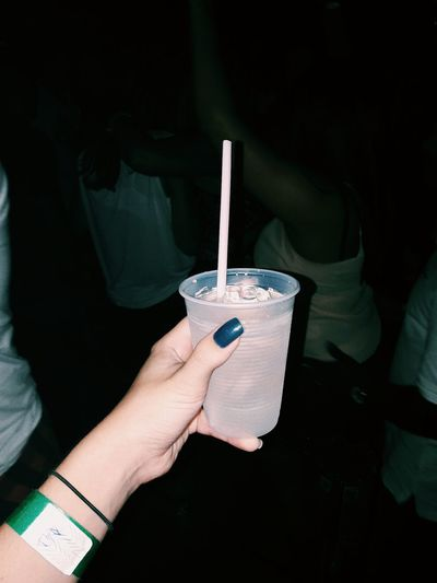 Cropped image of woman holding cold drink