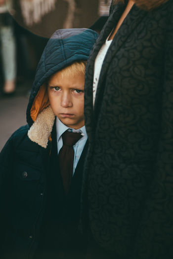 First day in school Clothing Contemplation Focus On Foreground Front View Hat Hood - Clothing Indoors  Leisure Activity Lifestyles Looking At Camera Males  Men One Person Portrait Real People Scarf Teenager Waist Up Warm Clothing Winter Young Adult Young Men