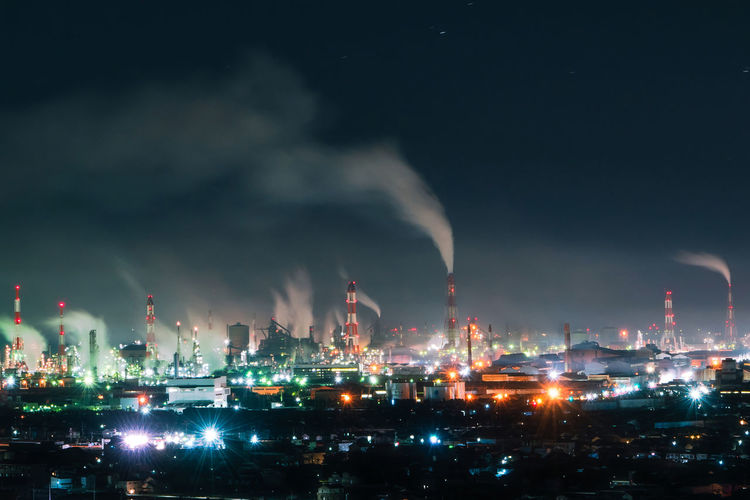 Building Exterior Factory Night Industry Architecture Illuminated Fuel And Power Generation Built Structure Smoke Stack Sky Environmental Issues Cloud - Sky Pollution Smoke - Physical Structure Environment No People Oil Industry Nature Outdoors Air Pollution Chemical Plant