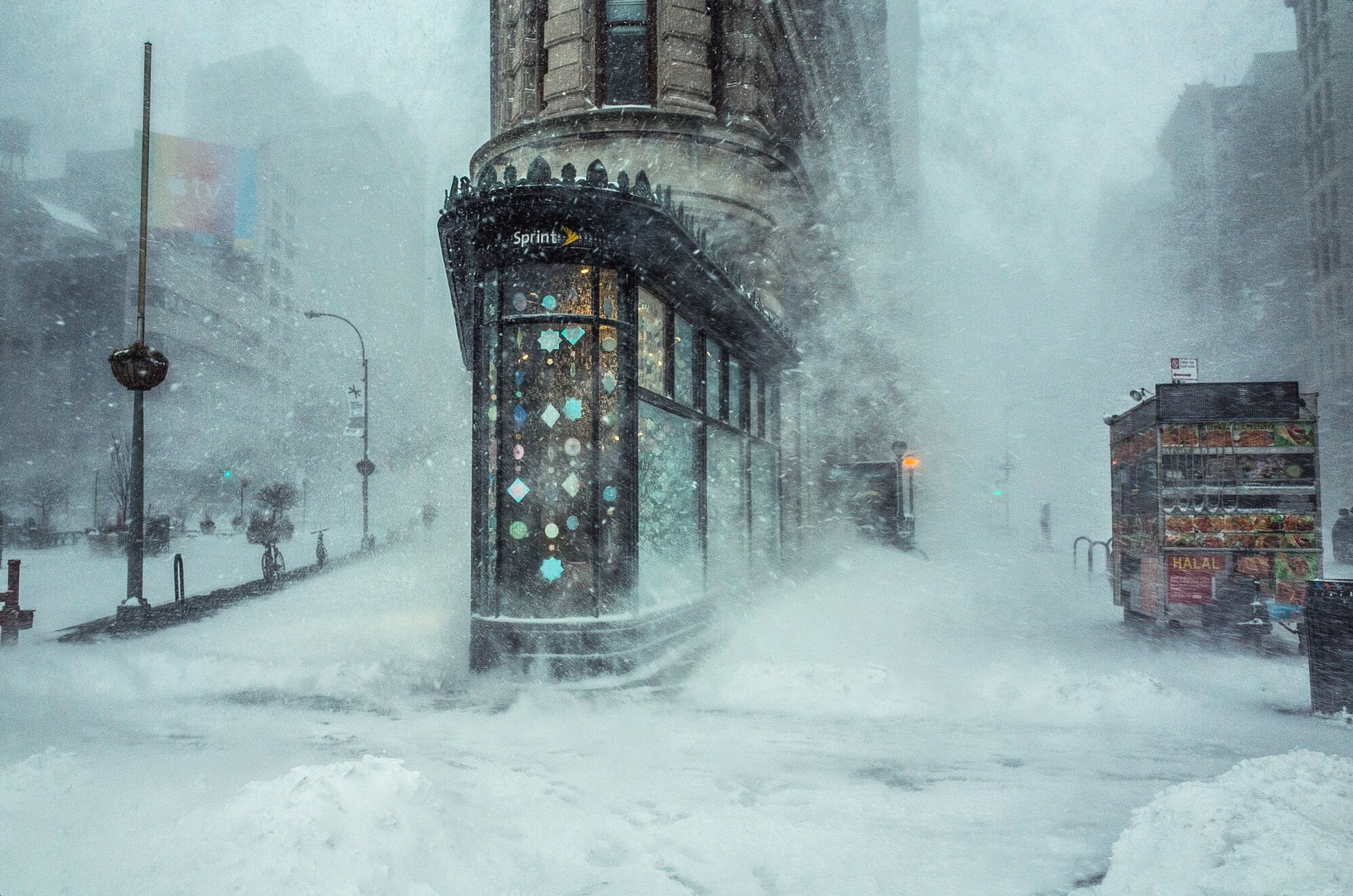 winter, cold temperature, snow, architecture, built structure, season, building exterior, weather, city, frozen, building, covering, travel destinations, glass - material, window, incidental people, day, outdoors, wet, motion