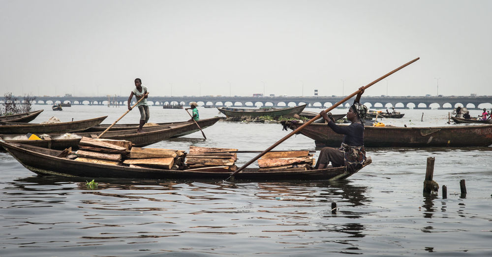 Lagos Lagos Lagoon Makoko Nigeria The Week On Eyem The Week on EyeEm Africa Documentary Fishing Boat Fishing Industry Lagoon Living On Water Mode Of Transportation Nature Occupation Sky Trade Boats Transportation Travel Water Waterfront Wood - Material