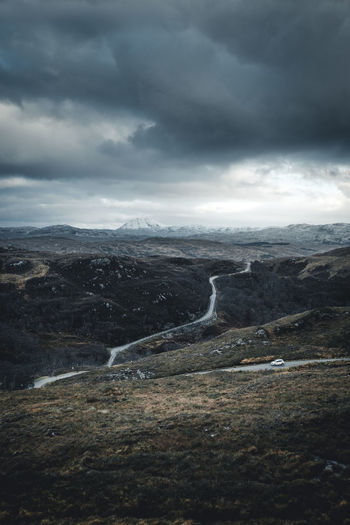 Heading up north. These curvy roads through the beautiful landscape of the Western Highlands are made to explore. Location: Western Highlands, Scotland. Equipment: Fujifilm X-T2 + XF18-55. Road Schottland Scotland Beauty In Nature Car Car On The Road Cloud - Sky Curvy Day Globetrotter Highlands Landscape Mountain Nature No People Outdoor Outdoors Road Scenics Sky Tranquil Scene Tranquility Weather Winding Winding Road Go Higher