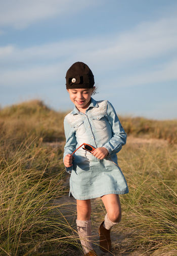 Full length portrait of boy standing on field