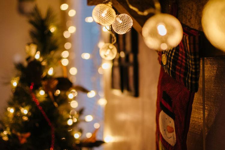 Close-up of illuminated christmas lights hanging on wood