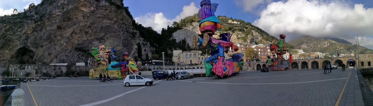 Maiori, Campania, Italy - March 4, 2019: Allegorical floats in the square of the port for the 46th edition of the Grand Carnival of Maiori Outdoors Panoramic Mountain Travel Road Architecture City Transportation Nature Leisure Activity Sky Crowd Lifestyles Real People Italy Campania Salerno Italy Grand Carnival Of Maiori Amalfi Coast Colorful Floats Carnival - Celebration Event Allegorical Floats Maiori, Day