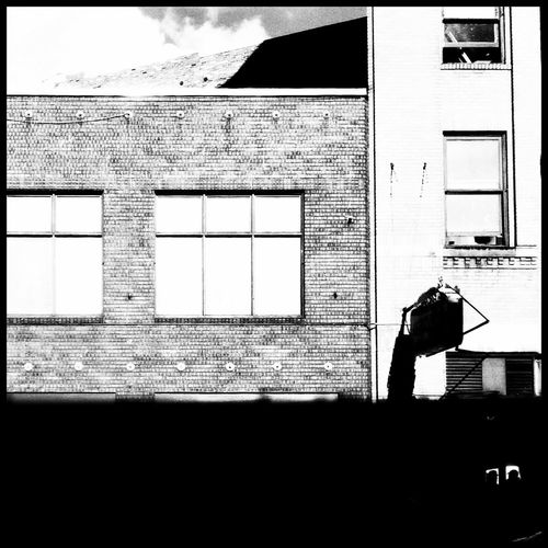 Silhouette of woman in building