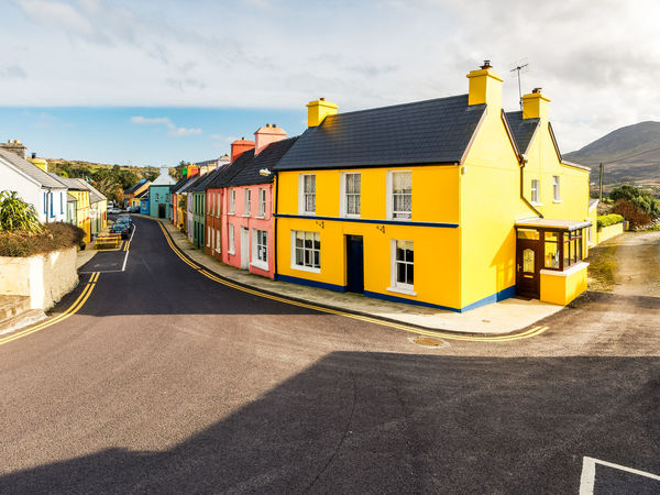 Coloured Houses Architecture Building Exterior Built Structure City Cloud - Sky Day House No People Outdoors Residential Building Road Sky Sunlight The Way Forward Yellow