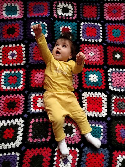 Baby Dila flying Flying Crochet Colors Red Yellow Girl Winter Child Rug Full Length Pattern Happiness Smiling People Day Real People