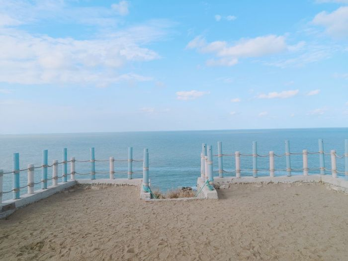 Sea Water Sky Beach Horizon Over Water Land Horizon Beauty In Nature Cloud - Sky Scenics - Nature Sand Tranquility Tranquil Scene Day Nature No People Idyllic Outdoors Railing