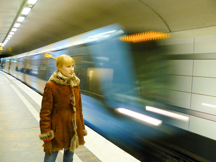 Woman next to subway train in motion Illuminated Lifestyles Metro Metro Station Motion Movement Public Transportation Slow Shutter Slow Shutter Speed Stockholm Subway Subway Station Subway Train Sweden Train Underground Underground Station  Warm Clothing Woman Neon Life Mobility In Mega Cities