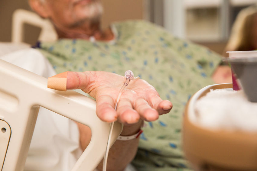 Elderly man holding his hand out while laying in a hospital bed. Cancer Hands Healthcare Helping Hope Hospital Hospital Bed Old Man Chemotherapy Elderly Elderly Man Grandpa Grandparent Grandparents Hand Healthcare And Medicine Help Helping Hand Helping Out Human Hand Medical Medicare Patient Real People Senior Adult