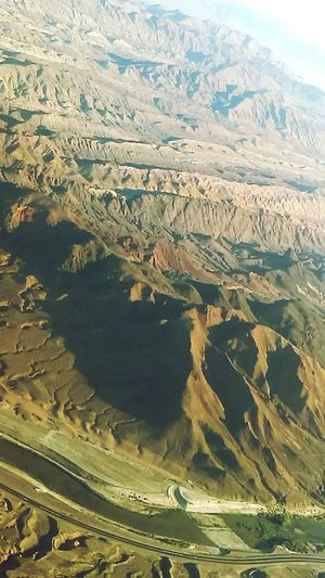 Mountains from the air on our trip to Vegas. Mountains Nature Nature_collection Nature Photography Mountain Range Mountains And Sky Mountain_collection Out My Window AirPlane ✈ On The Way On Vacation!  Adventure Club A Birds Eye View...