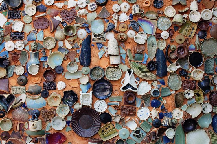 Full frame shot of pottery pieces on table