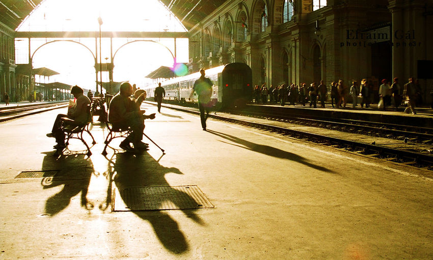 #analog #budapest #international #keleti #Morning #nikon #reportage #rush #sunshine #trainstation Architecture Bench Building Exterior Built Structure City Large Group Of People Only Men People