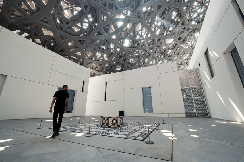 Louvre Louvre Abu Dhabi Real People Architecture Casual Clothing Tiled Floor Sunlight Sunbeam One Person Indoors  Built Structure Ceiling Flooring Building Modern Men Lifestyles Modern Architecture