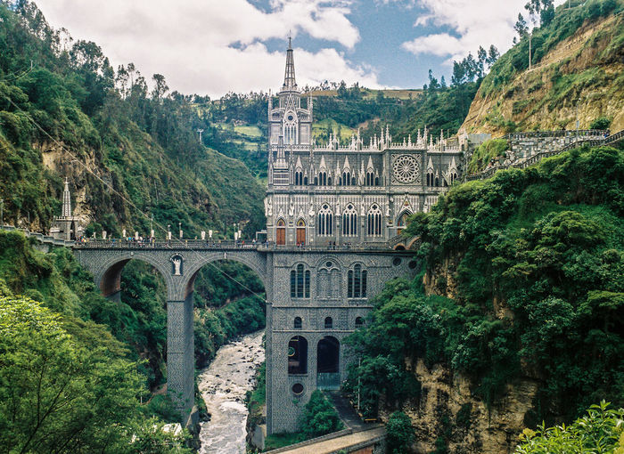 Las Lajas Sanctuary cathedral in the river gorge in Colombia Arch Architecture Bridge - Man Made Structure Building Exterior Built Structure Cathedral Church Day Faith Growth History Las Lajas Cathedral Lush Foliage Mountain Nature No People Pilgrimage Religion Sky Spirituality Travel Destinations Water Worship