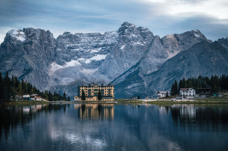 View of Misurina lake with large building of Institute Pius XII through bushes at sunset. Dolomites, Italy. Dolomites Dolomites, Italy Architecture Beauty In Nature Building Exterior Built Structure Cloud - Sky Italy Lake Misurina Mountain Mountain Range Nature Outdoors Reflection Scenics - Nature Sky Snowcapped Mountain Water Waterfront