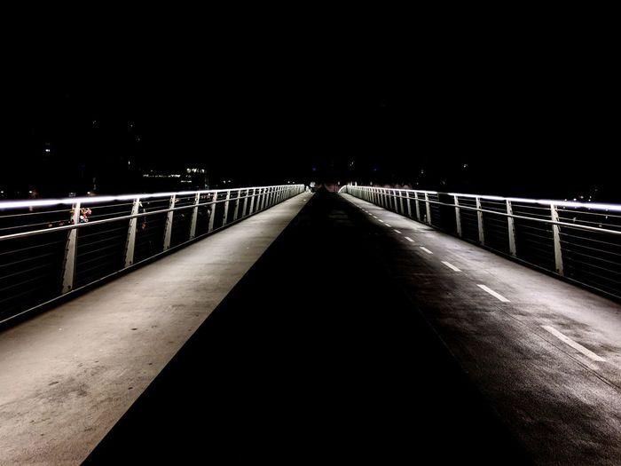 A bridge in Copenhagen - bike and pedestrian lanes separated. No cars. Night Bike Lane Footbridge Suspension Bridge Bridge - Man Made Structure City Road Railing Clear Sky Sky Bridge Diminishing Perspective Empty Road The Way Forward