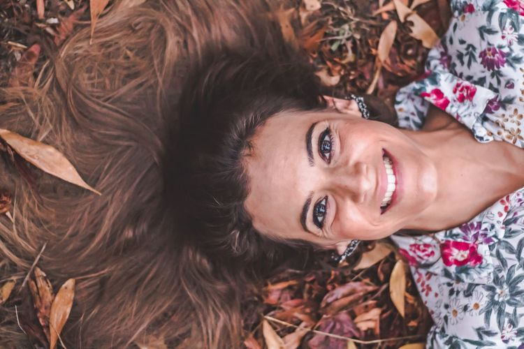 Looking At Camera Portrait Smiling Real People High Angle View Happiness Beautiful Woman Toothy Smile Lifestyles Lying Down One Person Cheerful Young Adult Young Women Beauty Women Flower Outdoors Day One Woman Only