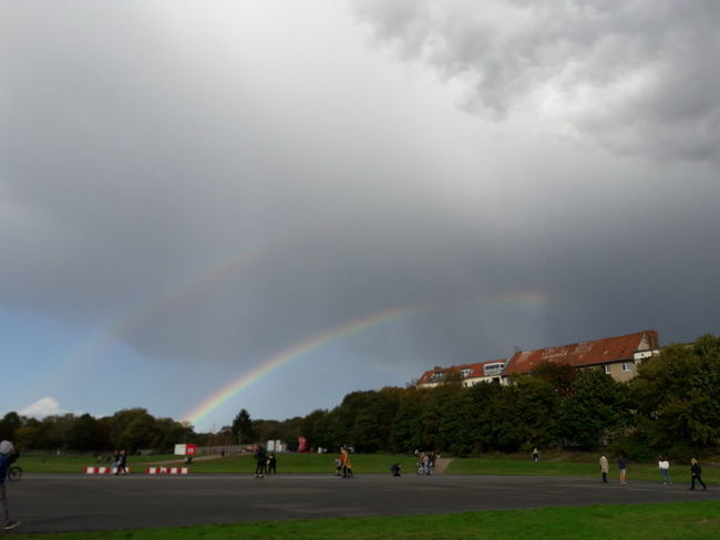 Tempelhofer Feld Park Park - Man Made Space Clouds In Berlin Germany Outdoors Urban Landscape Double Rainbow Weather Storm Cloud