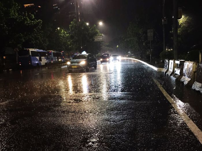 Wet city street during rainy season at night