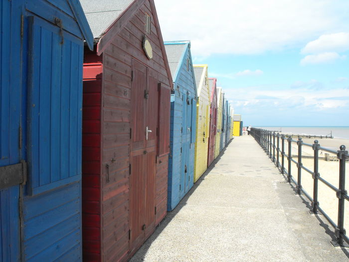 View of beach huts against sky