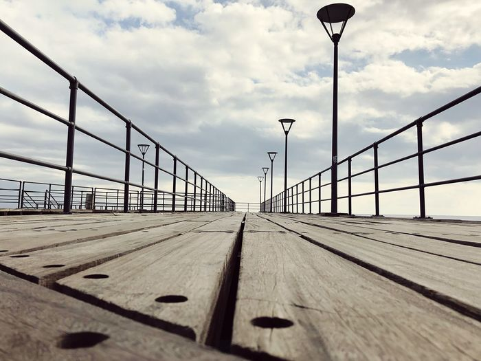 Wooden Clouds Lights Shapes Lines Wharf Pier Sky Cloud - Sky Nature Street Light Street Bridge Railing Built Structure The Way Forward Transportation Bridge - Man Made Structure Diminishing Perspective Direction No People Day Sunlight Lighting Equipment Architecture Connection Outdoors