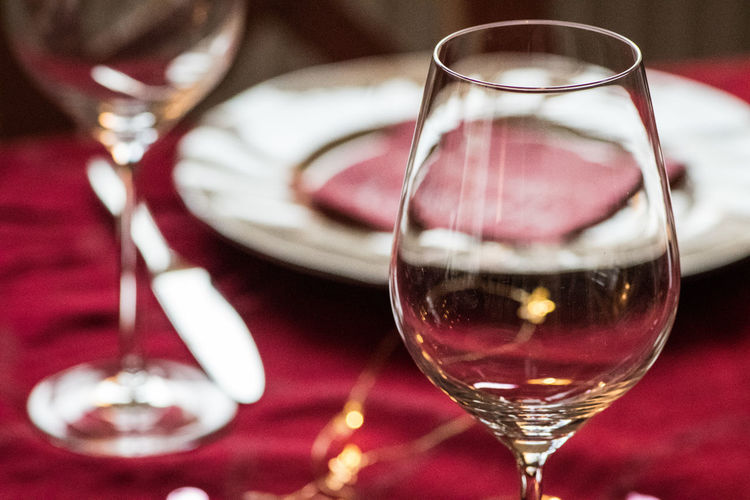 Alcohol Close-up Day Drink Drinking Glass Focus On Foreground Food And Drink Fork Freshness Half Full Indoors  No People Plate Red Red Wine Tea Light Wine Wineglass