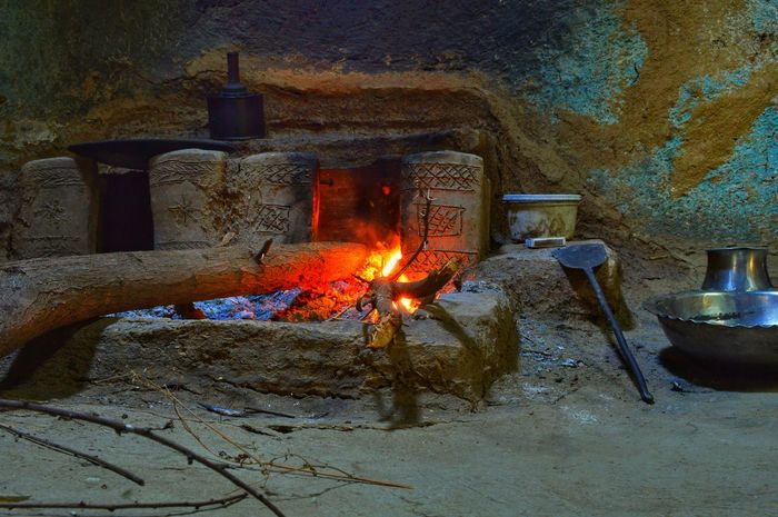 Beauty In Ordinary Things Beauty Of Decay Burning Burning Wood Chula Close-up Cooking At Home Flame Glowing Gujarat Home Is Where The Art Is Illuminated India Indianvillage Lit Old Simple Moment Simplicity.  Smoke Village Photography Village View Woods Colour Of Life