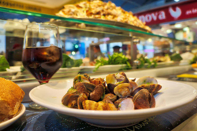 Close-up of clams served with drink on table