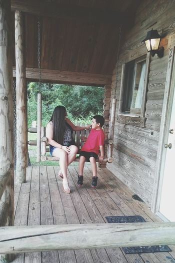 Two People Togetherness Bonding Friendship Day Cabininthewoods Cabin Cabin Life Cabins  Love ♥ Nature Outdoors Child Happiness Swing Bench Cabins