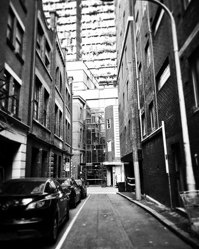 Back alley Blackandwhite Photography Blackandwhite Picoftheday EyeEm Gallery EyeEm Photography Architecture Built Structure Building Building Exterior City The Way Forward Day Direction Transportation Motor Vehicle Car Mode Of Transportation No People Land Vehicle Outdoors Arcade Corridor Sunlight Alley Ceiling