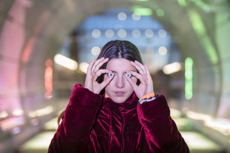 One Person Front View Real People Portrait Lifestyles Looking At Camera Focus On Foreground Headshot Warm Clothing Child Leisure Activity Clothing Childhood Winter Night Illuminated Women Standing Young Adult Scarf Hand Innocence Hood - Clothing
