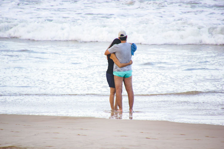 Couple Adult Ankle Deep In Water Beach Beauty In Nature Day Embracing Full Length Horizon Over Water Leisure Activity Lifestyles Nature Outdoors Real People Rear View Sand Scenics Sea Shore Sky Standing Vacations Walking Water Young Adult This Is Masculinity Summer Exploratorium A New Beginning #NotYourCliche Love Letter