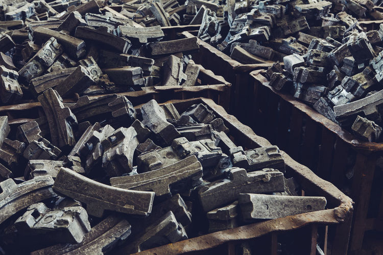 Full frame shot of old rubbers in containers at junkyard