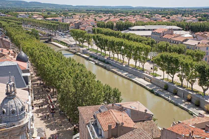 Architecture Bridge Bridge - Man Made Structure Building Building Exterior Built Structure City Cityscape Connection Day High Angle View Nature No People Outdoors Plant Residential District River Roof Town TOWNSCAPE Transportation Tree Water